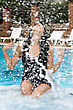Beautiful Young Brunette Splashes In Pool stock image