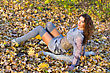Beautiful Young Woman Lying On Fallen Leaves stock photography