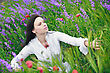 Beautiful Young Woman Smiling, Walking In A Field Of Flowers stock photography