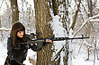 Beautiful Young Woman With A Sniper Rifle Near The Tree
