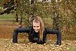 Beauty Female Doing Push Ups In The Park stock photo