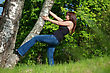 Beauty Tomboy Trying To Get Up The Tree stock photography