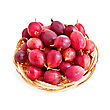 Berries Of Red Gooseberries On A Straw Wicker Plate Isolated stock photo