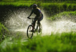 Biking Bicycling Through The Water stock photo