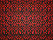 Black Leather Background With Red Victorian Ornament. Useful As Pattern