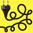 Black Plug With Cable On Yellow Background