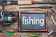 Blackboard With The Word Fishing, And Other Accessories stock photography