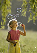 Outside Blonde Girl Blowing Bubbles stock photography