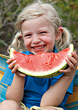 Blonde Girl In Pig Tails Eating Watermellon stock photography