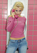 Blonde Teenage Girl with Pink Phone stock photo