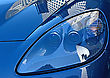 Blue Car Headlight Close Up And Buildings Reflection On The Hood stock photo