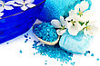 Essential Blue Salt In A Wooden Spoon, Soap, Towel, A Bowl Of Water And White Flowers Of Apple stock photo