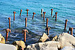 Rusty Blue Sea Water And Brokeb Pier Basic stock photography