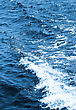 Blue Water Texture With White Wave stock photo