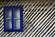 Blue Window Frame On The Old Wooden Hut stock photo