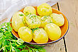 Boiled Potatoes With Dill, Butter Drizzled In Pottery, A Bunch Of Parsley, A Napkin On Wooden Board stock image