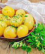 Boiled Potatoes With Dill, Drizzled With Oil In A Crockery, A Bunch Of Parsley, A Napkin On A Wooden Boards Background