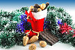 Small Boots With Sweets And Chocolate And Nuts, Golden Spruce Cones And Twigs On The Background stock photo