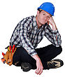 Bored Manual Worker Sat Cross-legged stock image