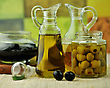 Bottles Of Olive Oil With Black And Green Olives stock photography