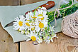 Bouquet Of Fresh Chamomile Flowers With Twine And A Knife On A Napkin On The Background Of Wooden Boards