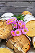 Bouquet Of Pink Flowers On A Pile Of Firewood Against The Old Gray Boards stock photo