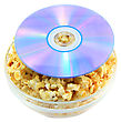 Film Bowl Full Of Caramel Popcorn With DVD Disk . Isolated stock photography