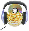 Bowl Full Of Caramel Popcorn With DVD Disk And Headphone . Isolated stock photography
