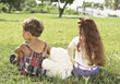 Boy and Girl Sitting in Grass stock photography