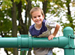 Smiling Boy at Playground stock photo