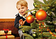 Boy Behind Christmas Tree stock photography