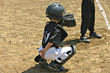Boy Catching During Baseball Game stock photo