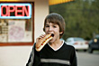 Boy Eating a Footlong Hot Dog stock image