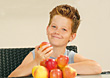 Boy Eating Apples stock photo