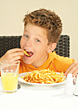People Eating  Boy Eating French Fries stock photography