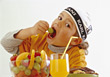 Boy Eating Fruits stock photo