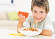 Boy Eating Spagetti stock photo