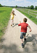 Boy & Girl Running On Countryside stock photography