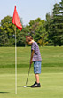 Boy Golfing stock photo