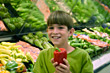 Boy Holding Pepper in Grocery Store stock photo