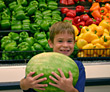Boy Holding Watermelon in Store