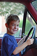 Boy in Drivers Seat of Truck stock photography