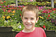 Boy in Front of Flowers