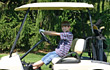 Boy in Golf Cart stock photo