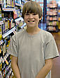 Boy in Grocery Store stock photography