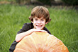 Outside Boy on Large Pumpkin stock photo