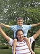 Boy on Mans Shoulders stock photo