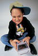 Boy Playing Gameboy stock photography