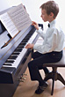 Instrument Boy Playing Piano stock photography
