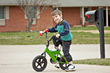Smiling Boy Riding Bike stock photography